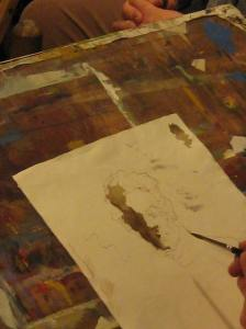 Watercolor wash has been moved about to indicate the stucture of Adam's face